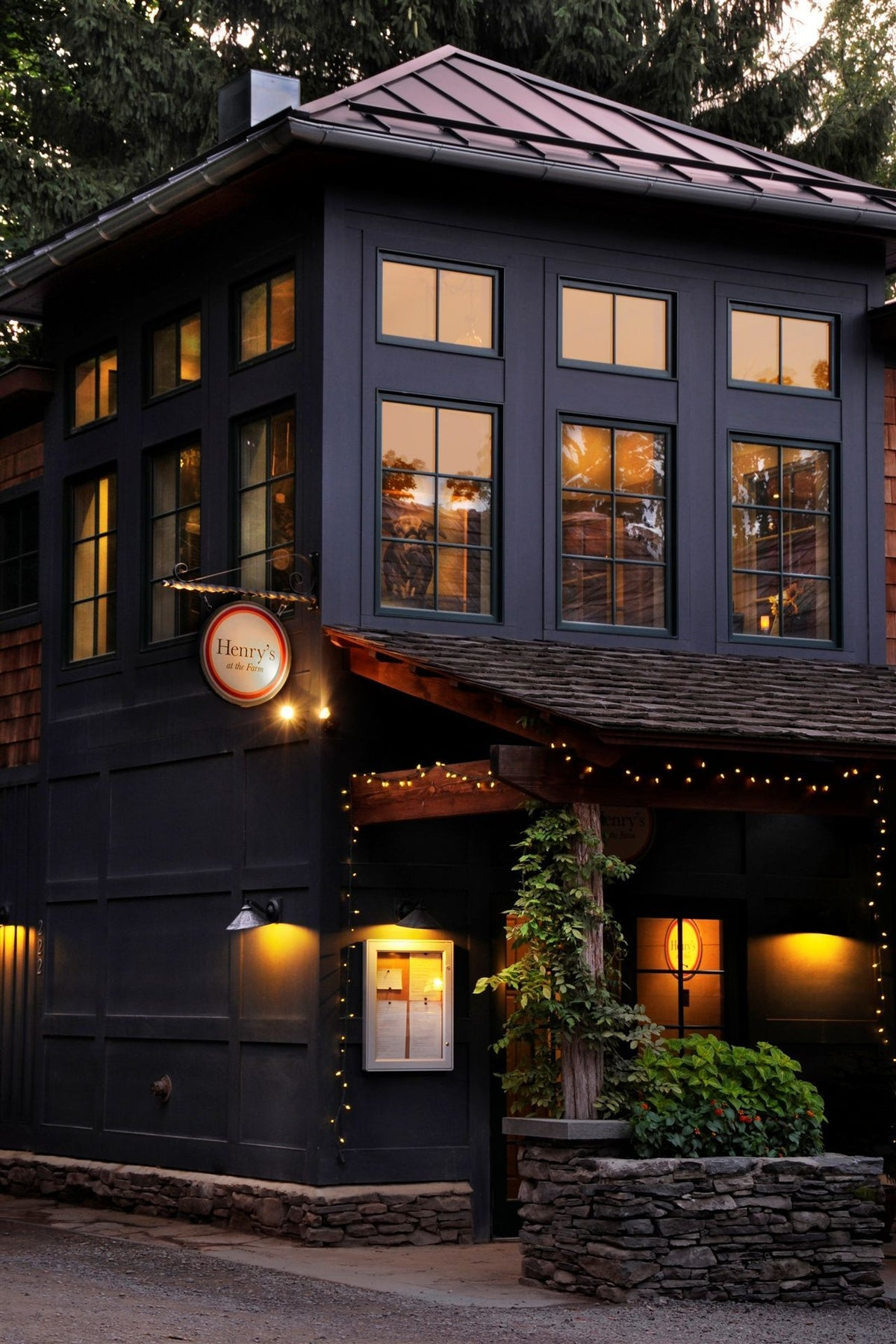 Buttermilk Falls Inn, NY - Henry's Restaurant, exterior of modern farmhouse at nighttime