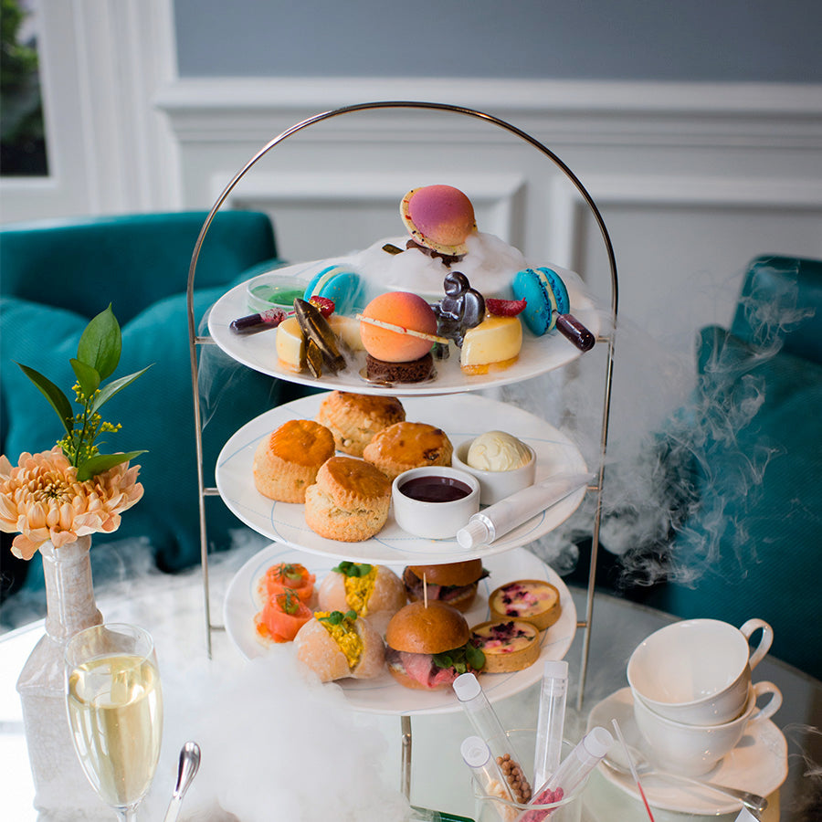 The Ampersand Hotel, London - Drawing Room high tea spread with pastries, desserts, and finger sandwiches