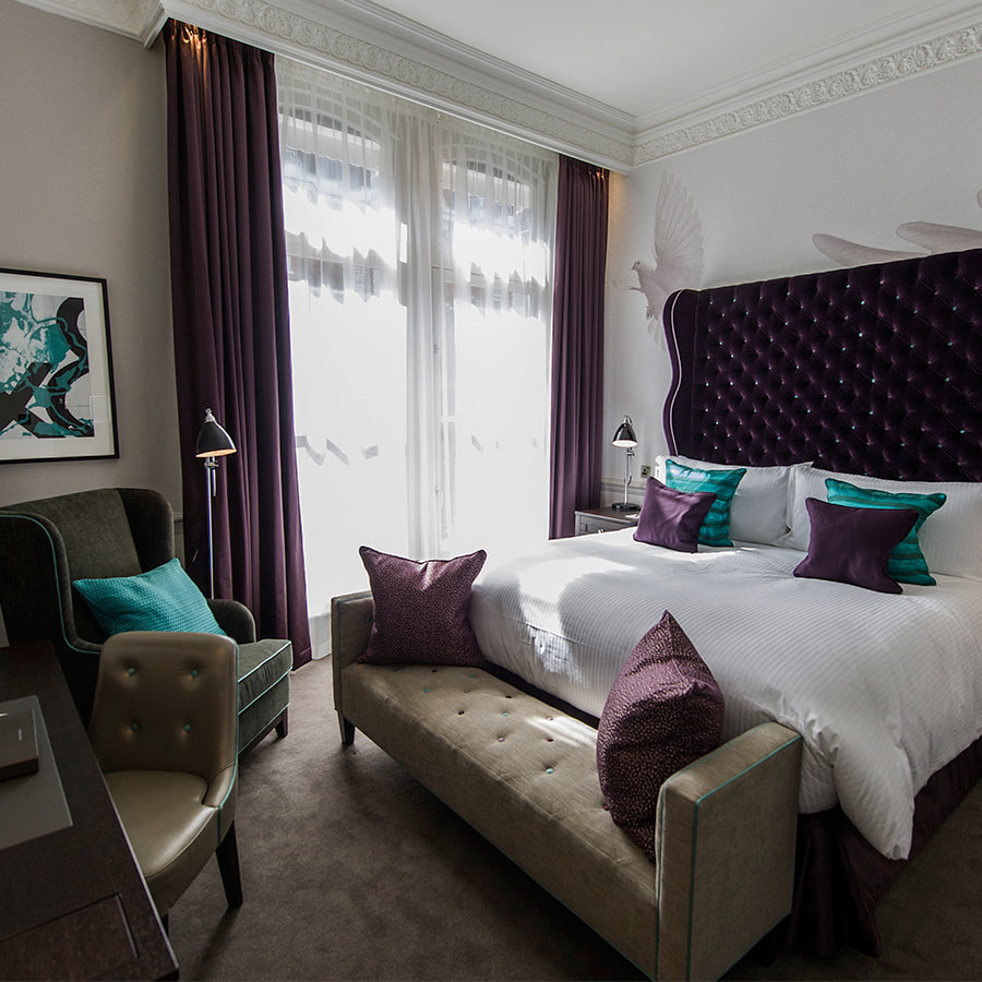 The Ampersand Hotel, London - hotel room with purple accents and beige furniture