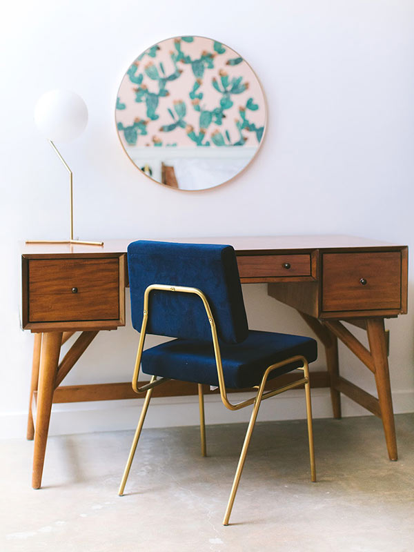 ARRIVE Phoenix, Phoenix, AZ - hotel room with contemporary wooden desk, blue velvet chair, and round wall mirror