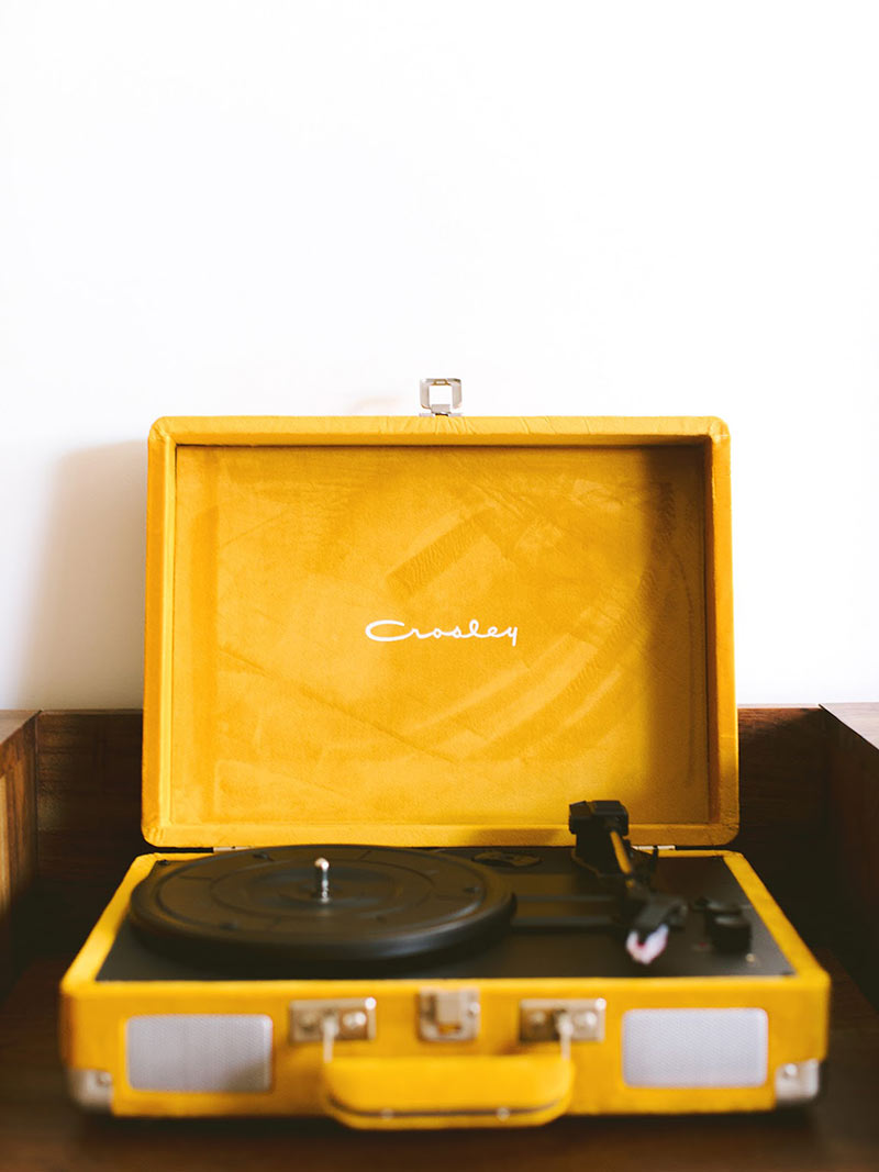 ARRIVE Phoenix, Phoenix, AZ - close up of yellow Crosley record player in hotel room