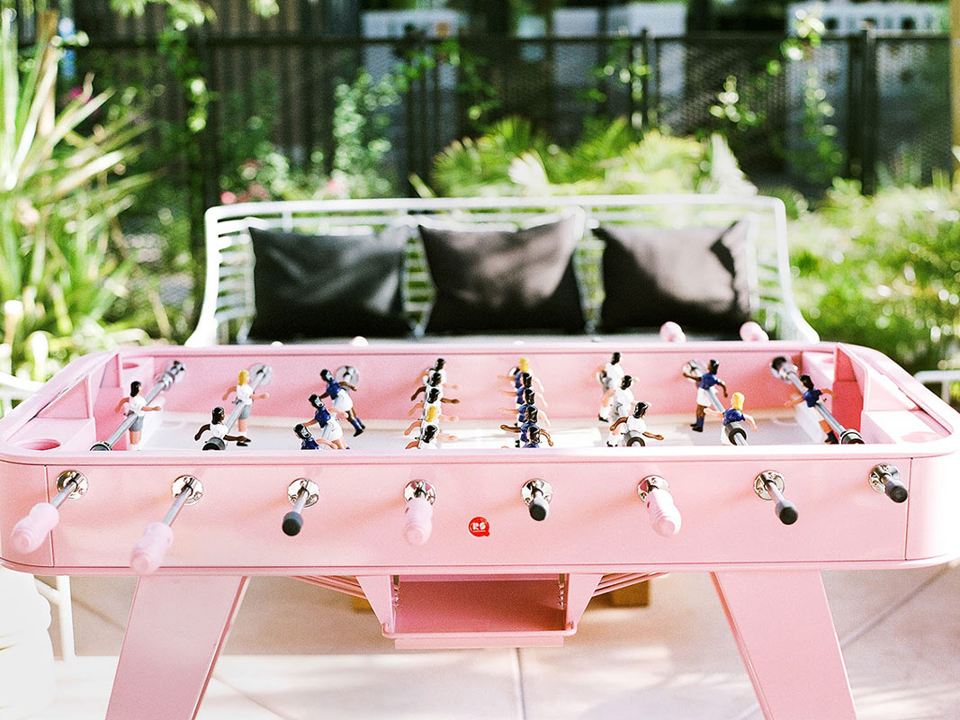 ARRIVE Phoenix, Phoenix, AZ - close up of hotel patio and pink foosball table