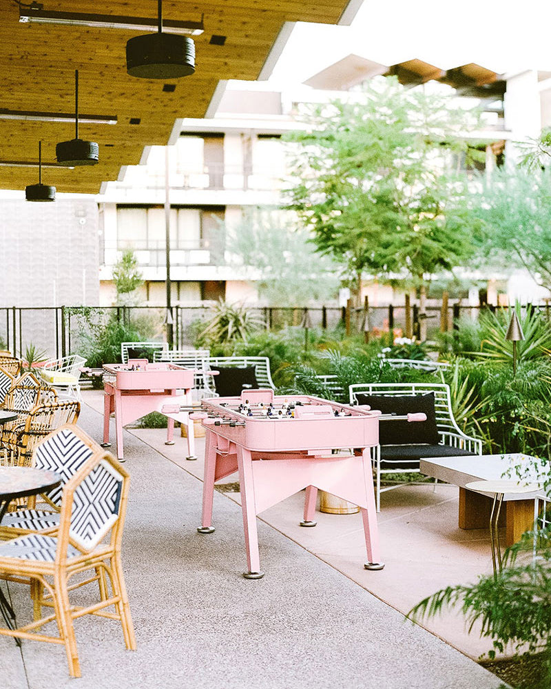 ARRIVE Phoenix, Phoenix, AZ - hotel patio with contemporary chairs and tables featuring pink foosball tables