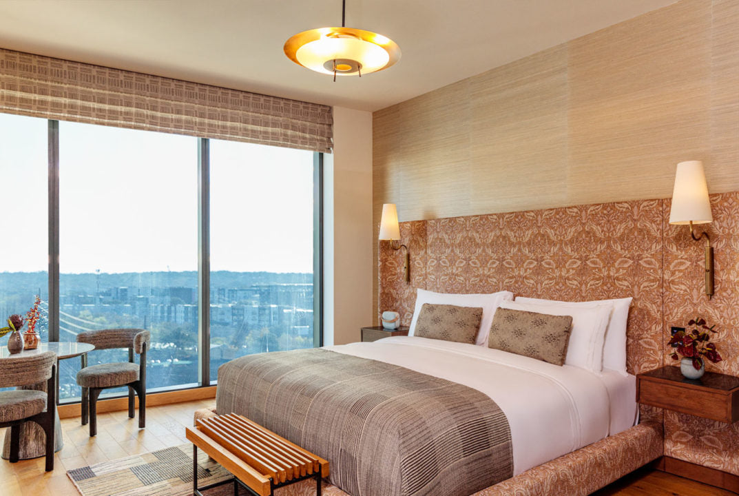 Austin Proper Hotel, Austin - hotel room with bed, orange patterned headboard, and floor to ceiling windows overlooking city
