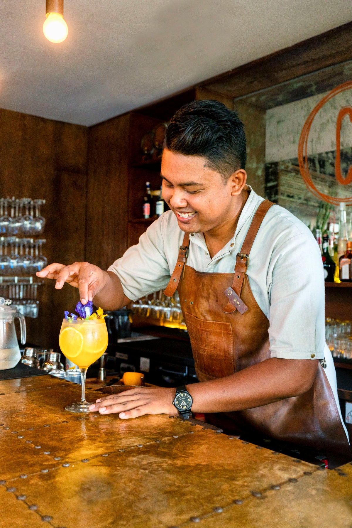 Bisma Eight, Bali - bartender shaking a drink at a bar