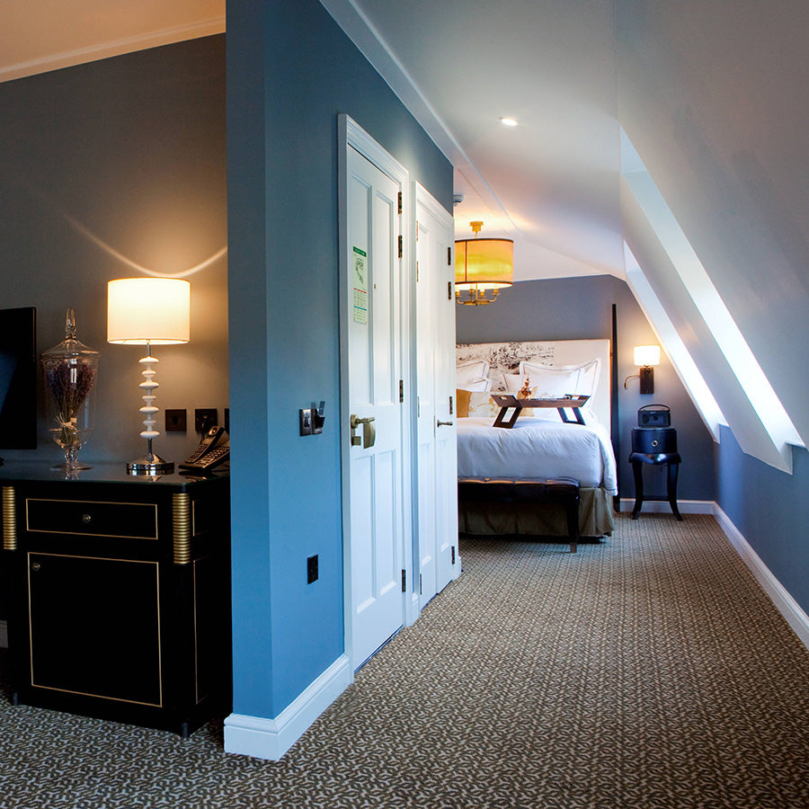 The Gainsborough Bath Spa, Bath - hotel room with dark furniture, powder blue walls, and bed with breakfast tray