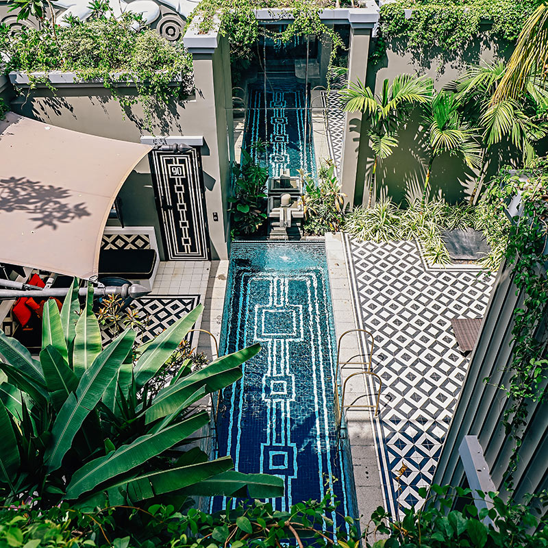 Bensley Collection Shinta Mani, Siem Reap - villa private pool with black and white tiling, greenery, and canvas sun shade