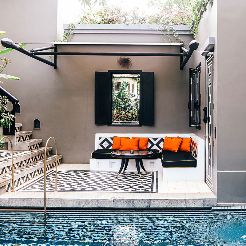 Bensley Collection Shinta Mani, Siem Reap - villa private pool patio with outdoor couch and black and white diamond tiling