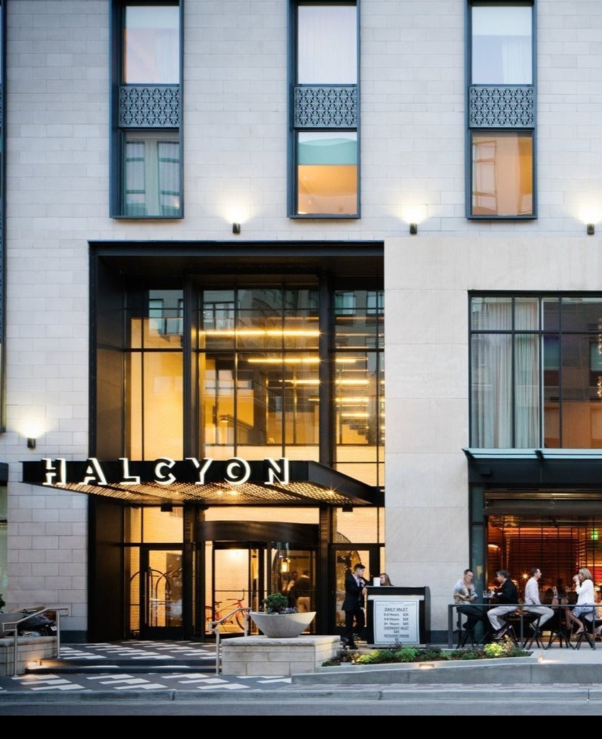 Halcyon, a hotel in Cherry Creek, Denver - exterior of a modern hotel with large windows and front patio