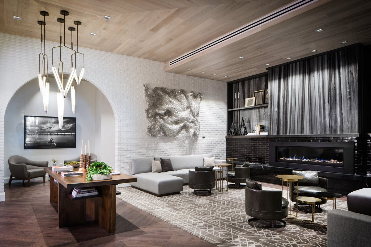 Halcyon, a hotel in Cherry Creek, Denver - hotel living room with black and white design theme, couches, arm chairs, and side tables
