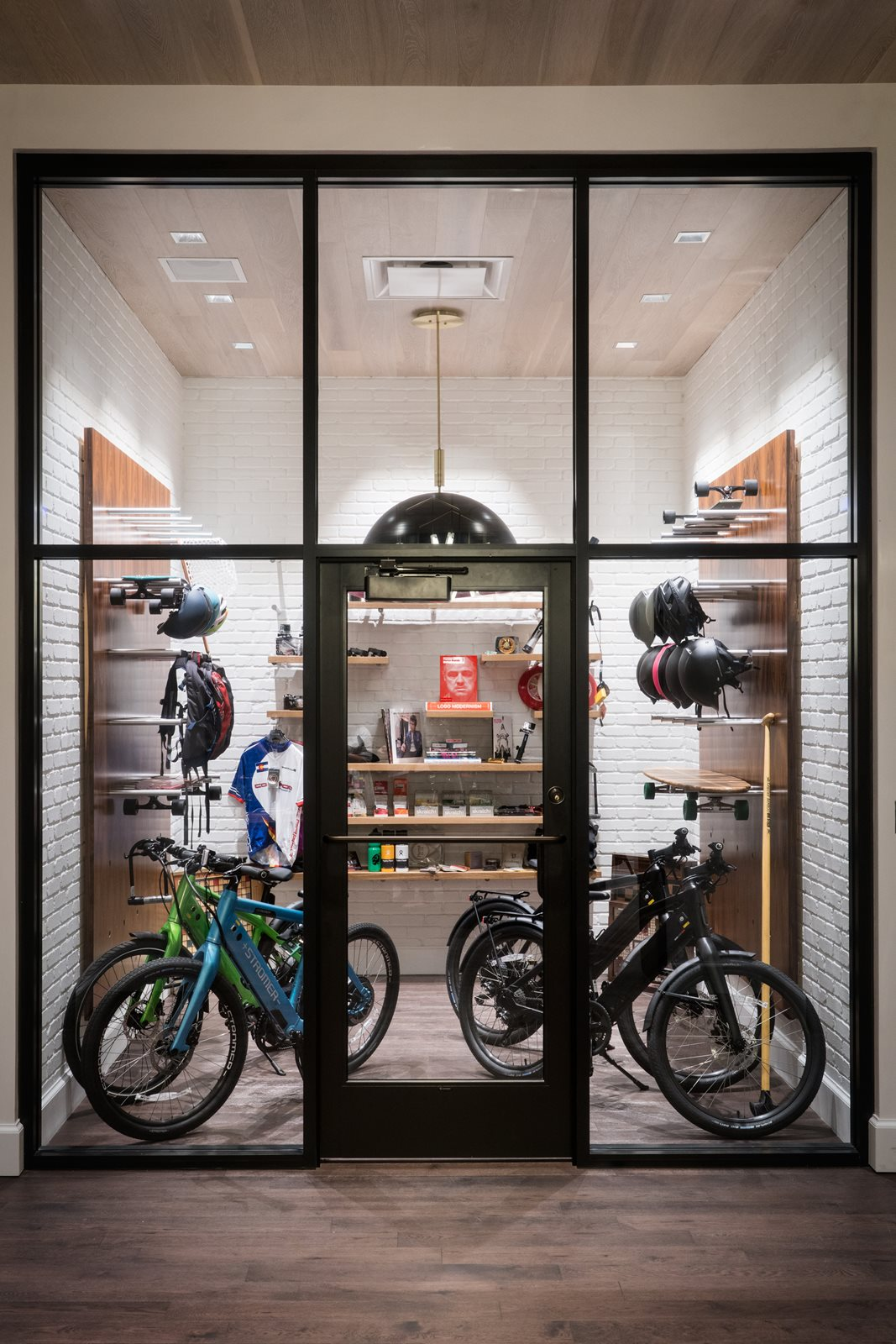 Halcyon, a hotel in Cherry Creek, Denver - bike shop with parked bikes, helmets on racks, and a counter