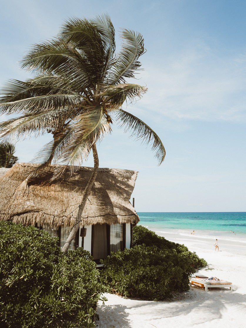 Casa Violeta, Tulum - beachside thatch roof cottage with beach access and lounge chairs
