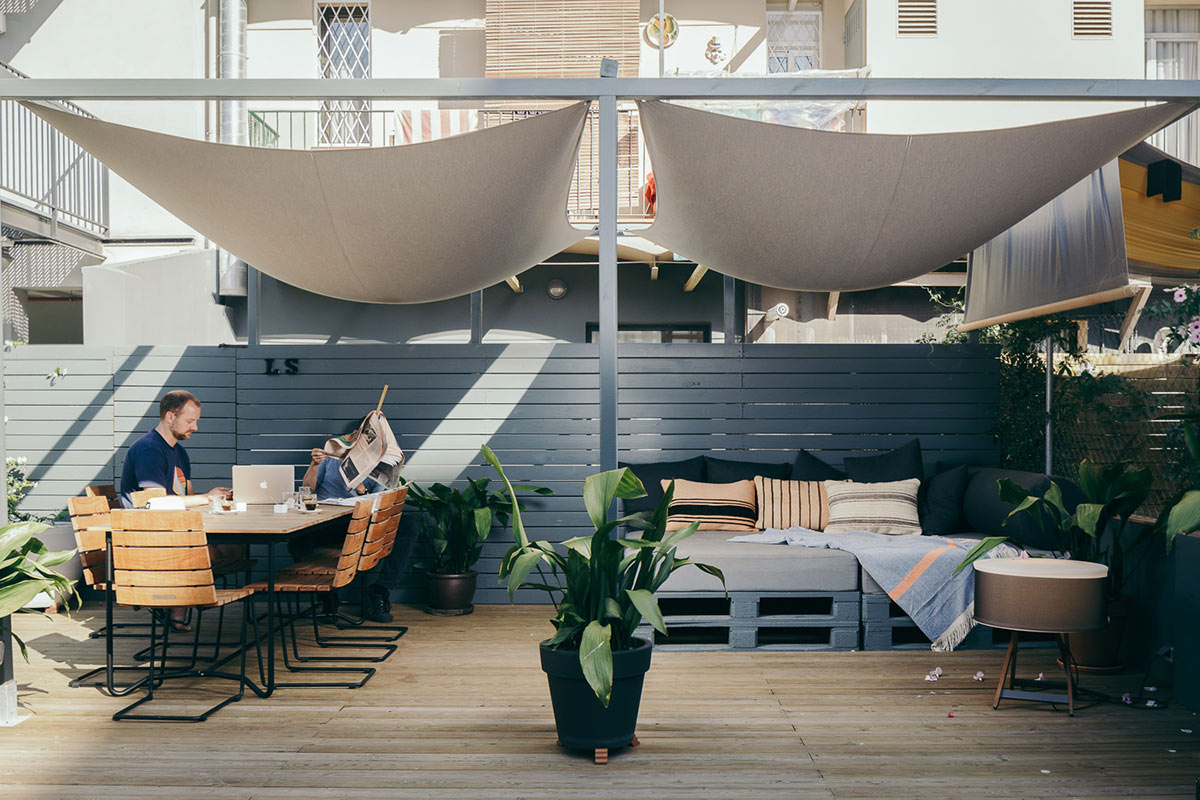 Hotel Brummell, Barcelona - rooftop lounge with table, chairs, lounge bed, and canvas sunshades