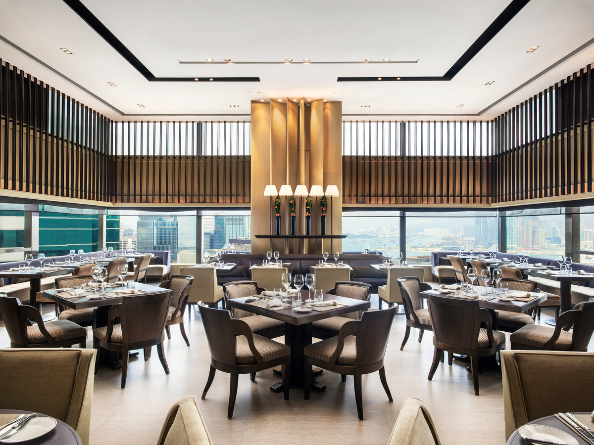 The Upper House, Hong Kong - Cafe Gray Deluxe restaurant with set tables and windows overlooking city