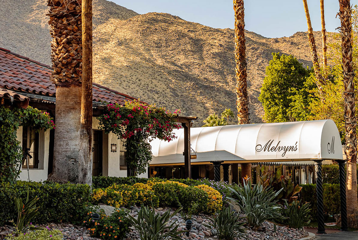 "Ingleside Inn, Palm Springs - hotel exterior with a white awnings reading ""Melvyn's"""