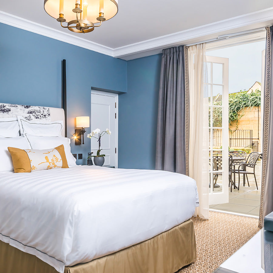 The Gainsborough Bath Spa, Bath - luxurious hotel room with bed, powder blue walls, and doors leading to private patio