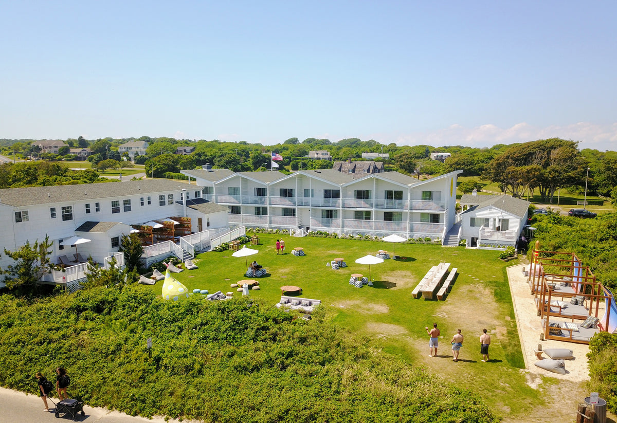 Hero Beach Club, Montauk - view of hotel property including buildings, green lawn, and canopy lounge beds