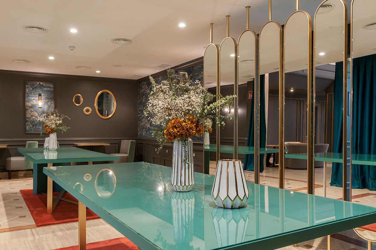 Hotel Eugenia de Montijo, Toledo - hotel lounge with large teal tables and large gold mirror decorations