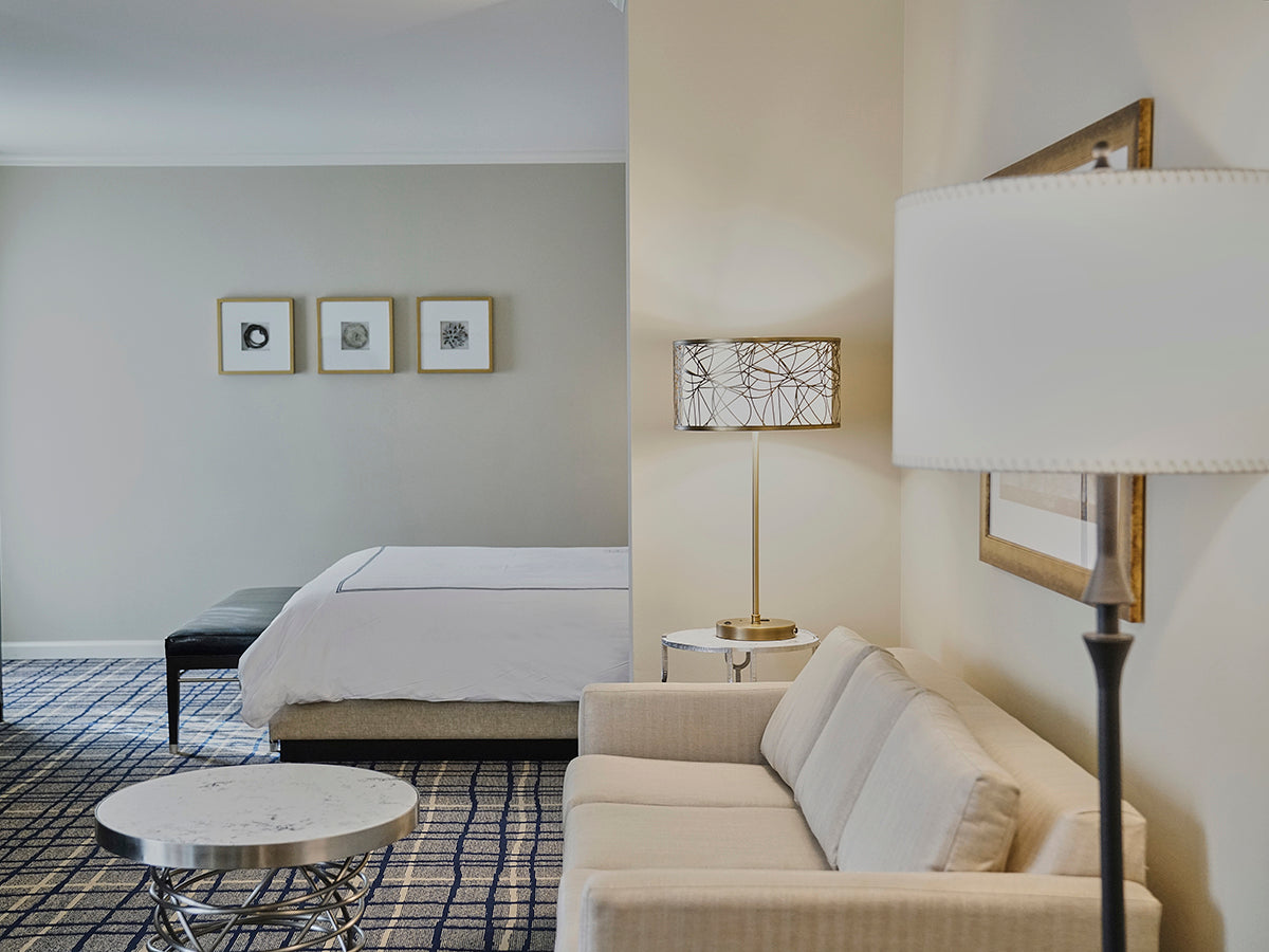 The Adolphus Hotel, Dallas - neutral hotel room with white furniture and decorations and plaid carpet