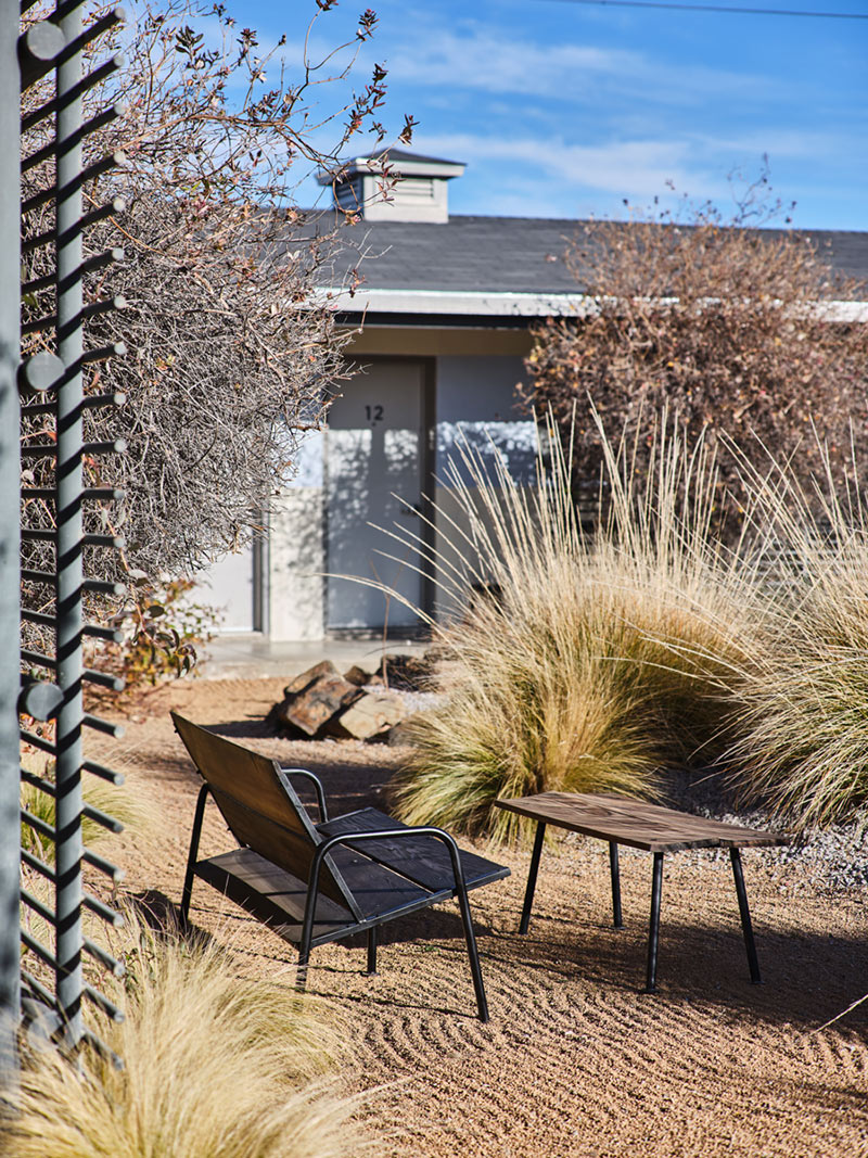 Thunderbird Hotel, Marfa - villa backyard with sand, dune grass, and view of villa