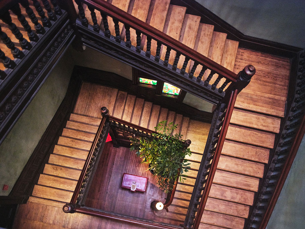 The Columns Hotel, New Orleans - birds eye view of square winding wood staircase