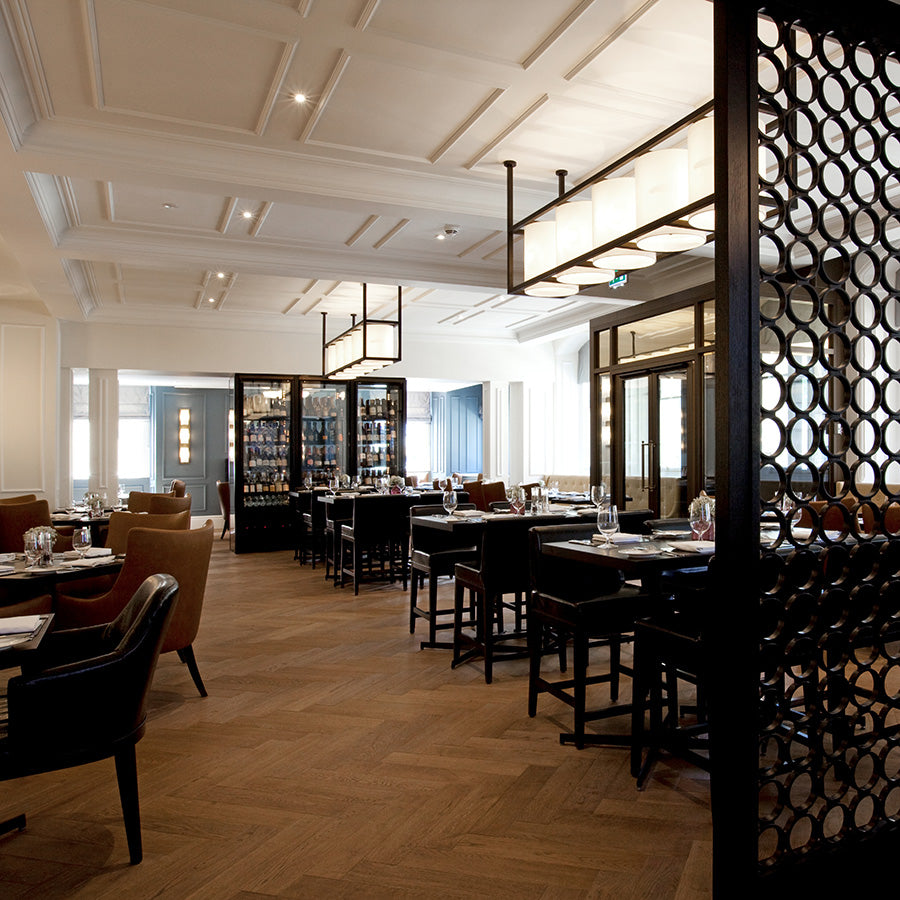 The Gainsborough Bath Spa, Bath - Dan Moon restaurant with dark tables and chairs, contemporary hanging lights, and alcohol cabinet