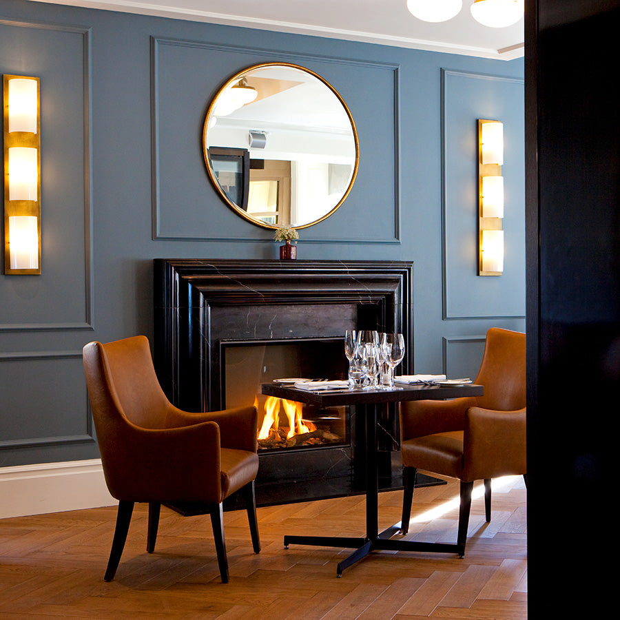 The Gainsborough Bath Spa, Bath - Dan Moon restaurant with blue moulded walls, tan leather armchairs, and set table
