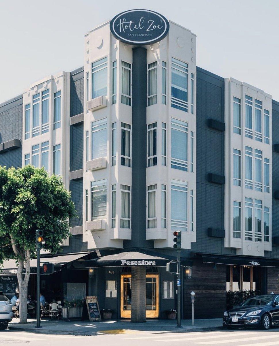 Hotel Zoe Fisherman's Wharf, San Francisco - hotel exterior with dark paneling and white bay windows