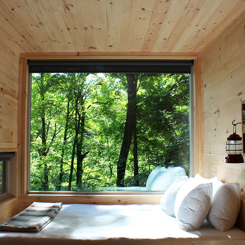 Getaway Piney Woods, Larue - hotel room with wooden walls, bed next to a huge window overlooking forest