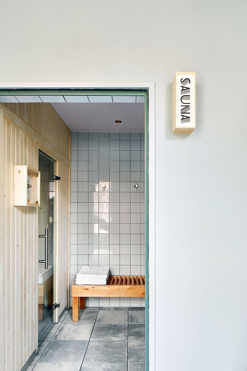 Hotel Brummell, Barcelona - hotel sauna with light wood bench, folded towels, and tile floors and walls