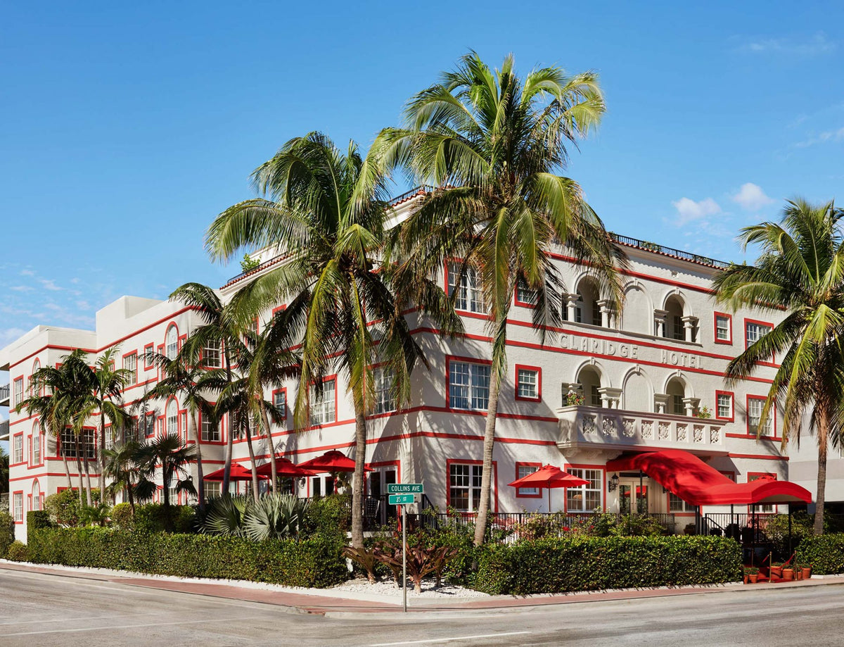 Casa Faena, Miami Beach - exterior of Spanish-style hotel with red trimmings and a red awning over the entrance