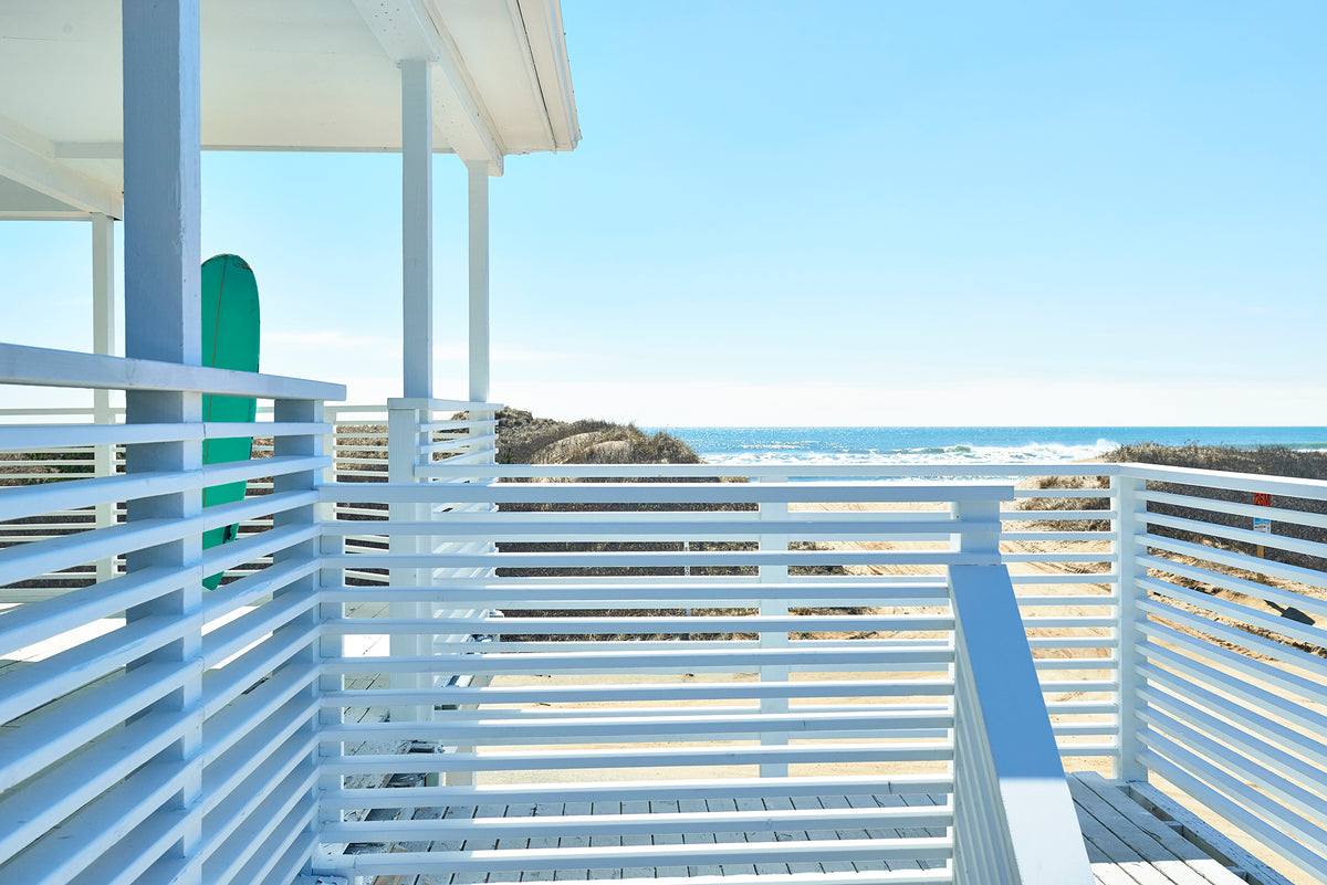 Hero Beach Club, Montauk - white wooden bannisters and staircase with view of beach and ocean