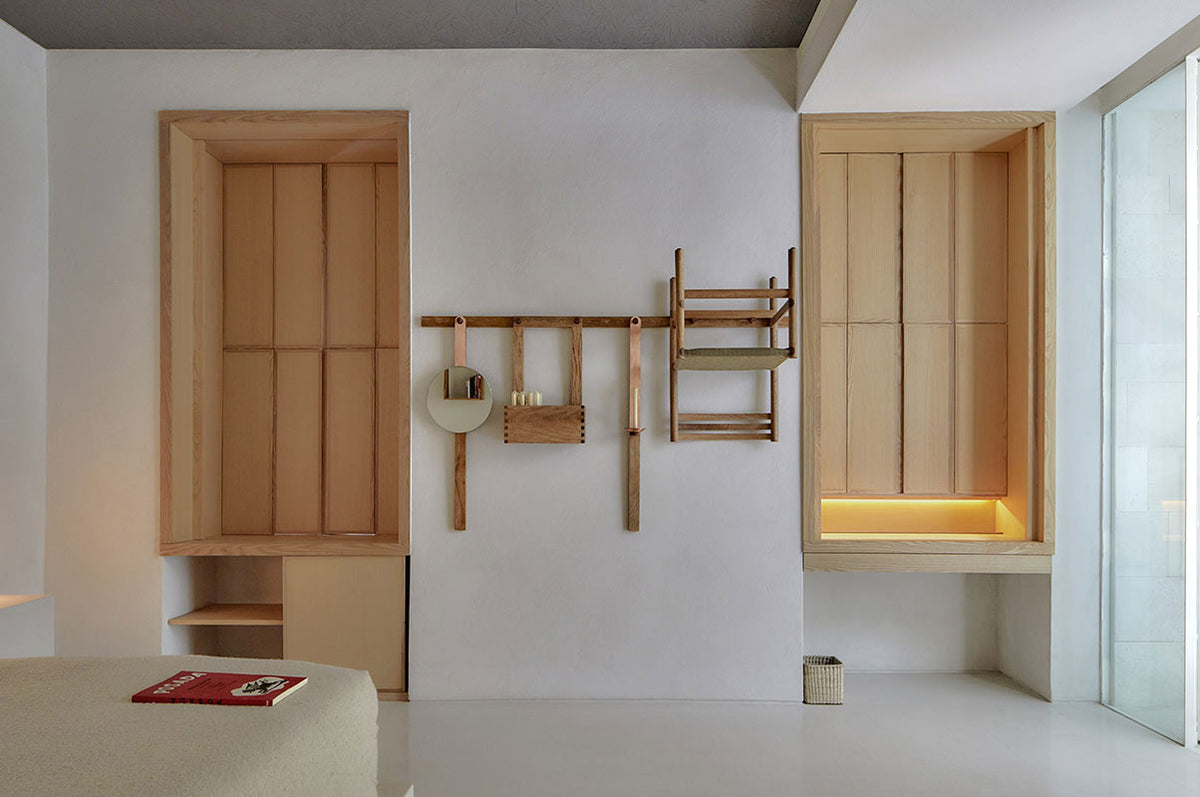 Círculo Mexicano, Mexico City - hotel room with two shuttered windows and a minimalist wall rack with mirror