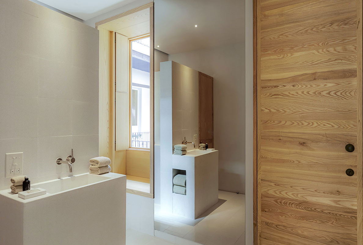 Círculo Mexicano, Mexico City - minimalist hotel bathroom with floor to ceiling mirror, simple white sink, and large balcony windows