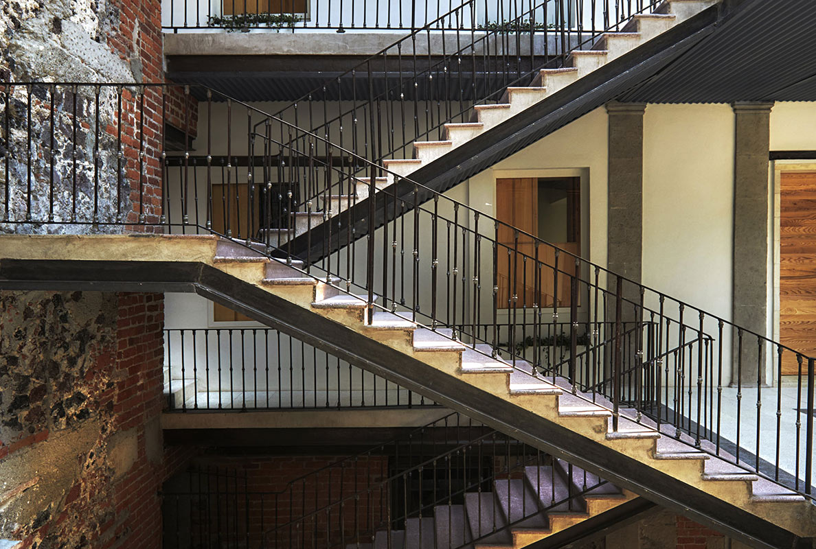 Círculo Mexicano, Mexico City - classic staircase with iron rails and exposed brick wall