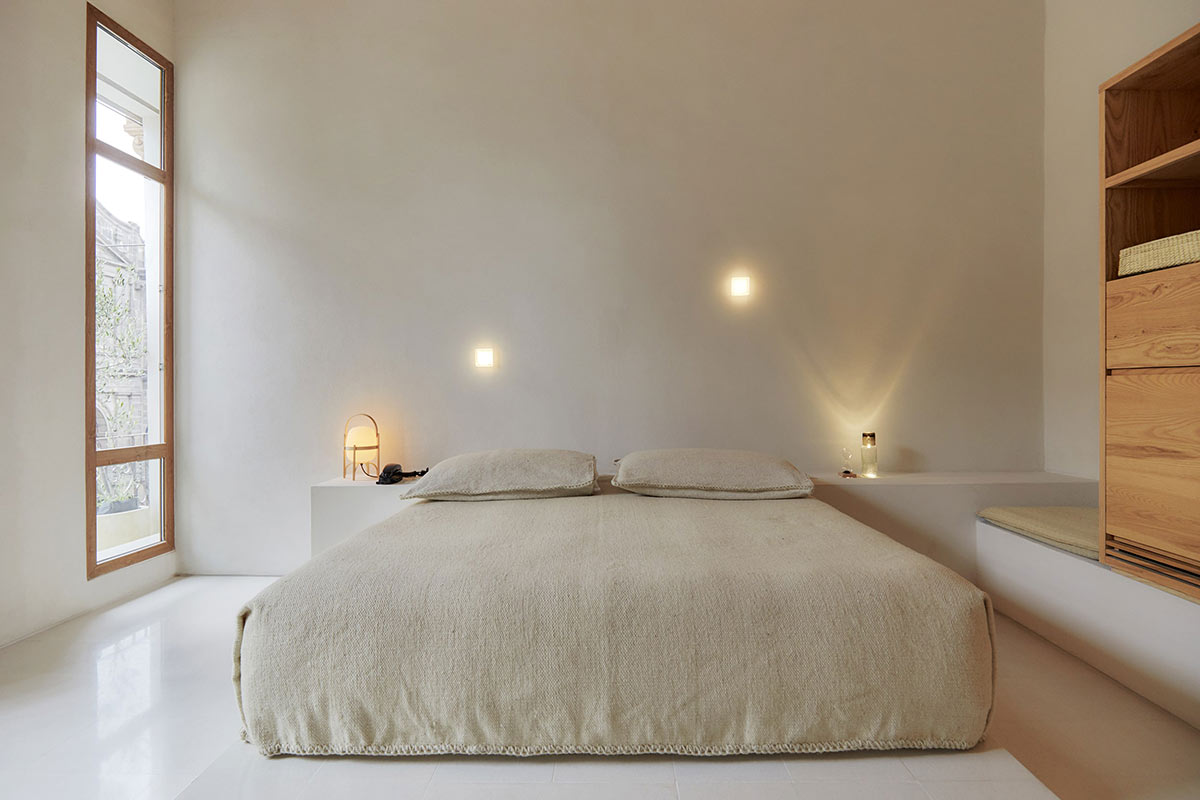 Círculo Mexicano, Mexico City - minimalist hotel room with wooden closet, simple bed, and large balcony window