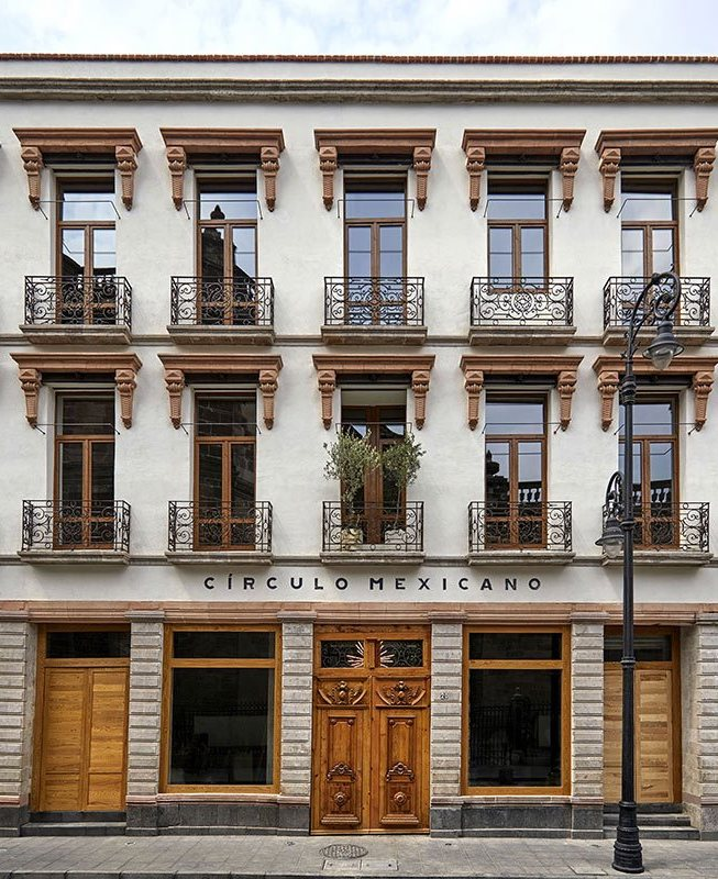 Círculo Mexicano, Mexico City - hotel exterior, white colonial style building with iron balconies and wooden accents