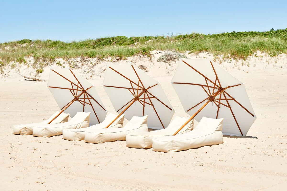 Hero Beach Club, Montauk - resort beach with bean bag lounge beds and white sun umbrellas on sand