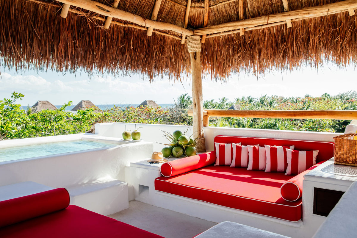 Hotel Esencia, Xpu-Ha - thatch roof cabana with red lounge couches, coconut drinks, and a private pool