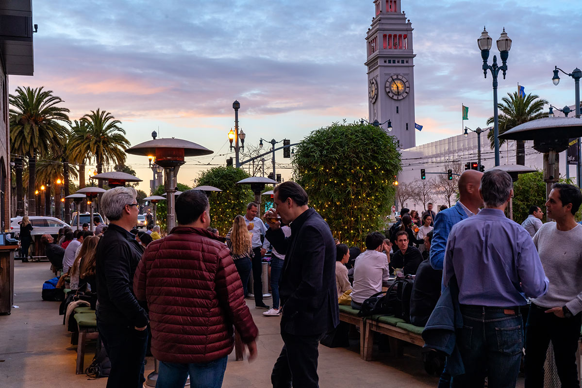 Hotel Vitale, San Francisco - outdoor patio with heat lamps, people drinking, and city view