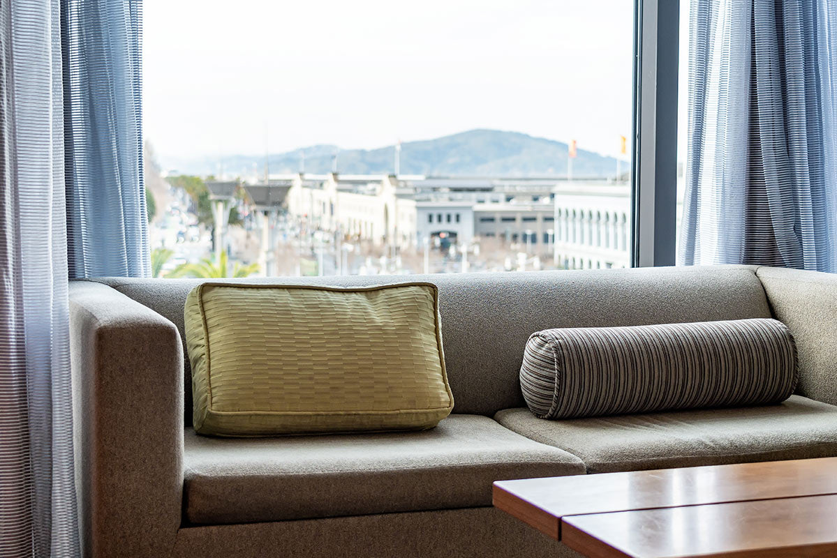 Hotel Vitale, San Francisco - close up of grey couch and window overlooking city