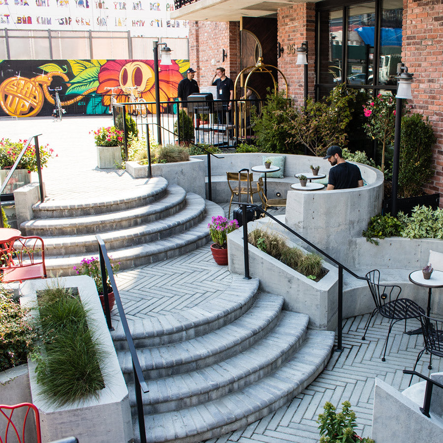 The Williamsburg Hotel, NYC -  hotel rooftop lounge with stone stairs and stone bench seating