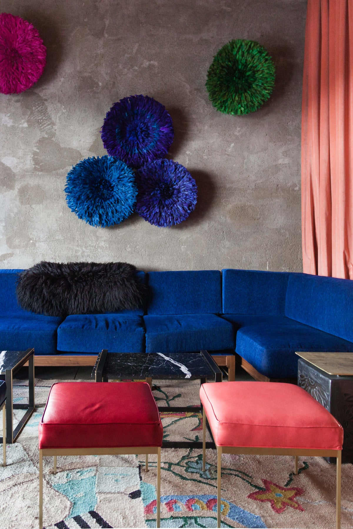 Thunderbird Hotel, Marfa - hotel lounge with vibrant decor in industrial chic setting
