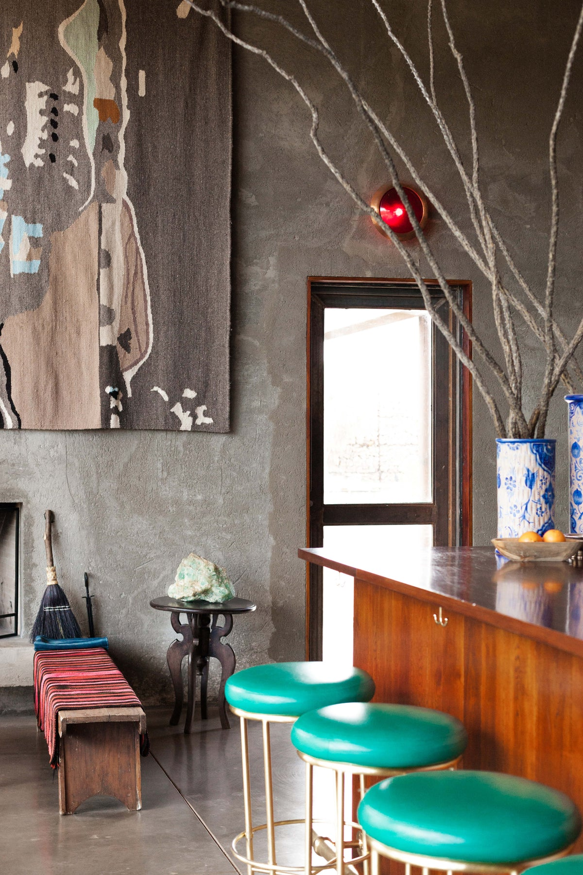 Thunderbird Hotel, Marfa - hotel bar with teal and gold barstools in industrial chic setting