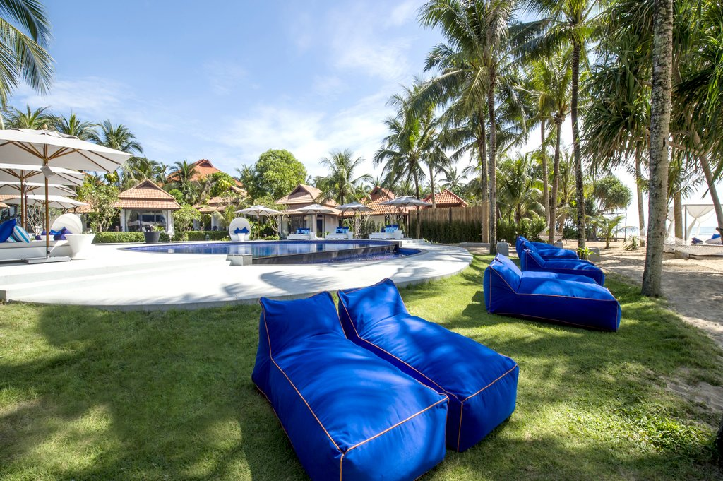 Akyra Beach Resort, Phuket - hotel resort pool view with lounge beds and bean bags