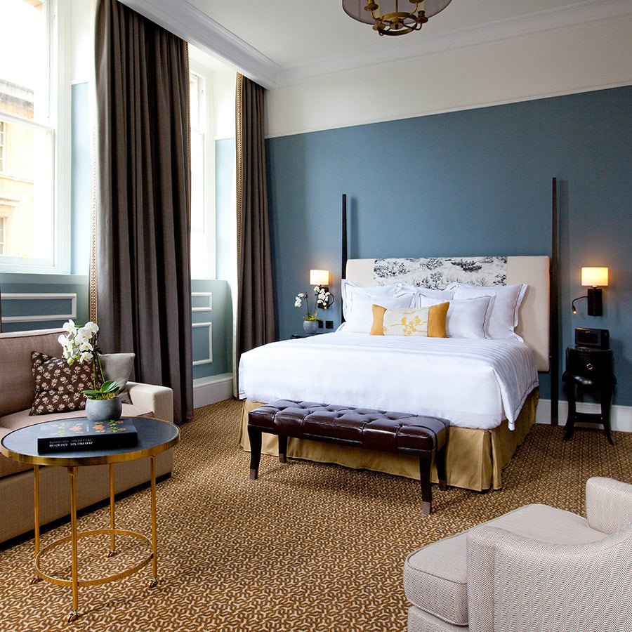 The Gainsborough Bath Spa, Bath - hotel room with beige furniture, powder blue walls, and grey curtains