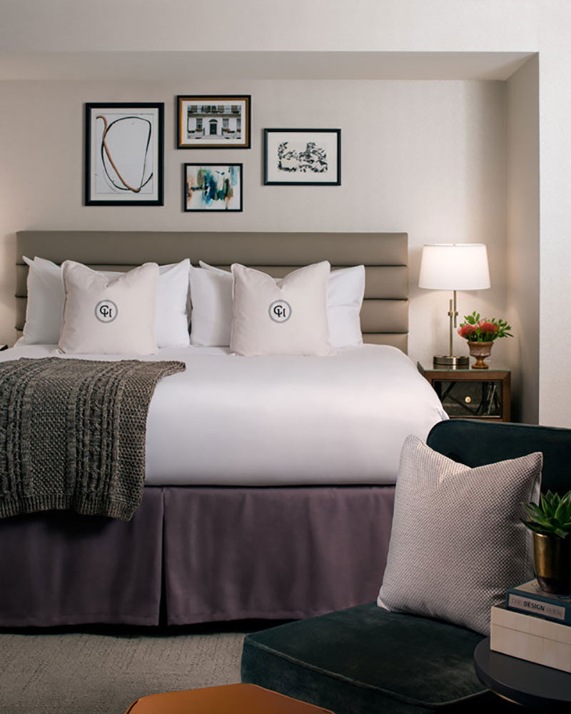 Claridge House, Chicago - hotel room with plush king bed, grey headboard, and grey skirt