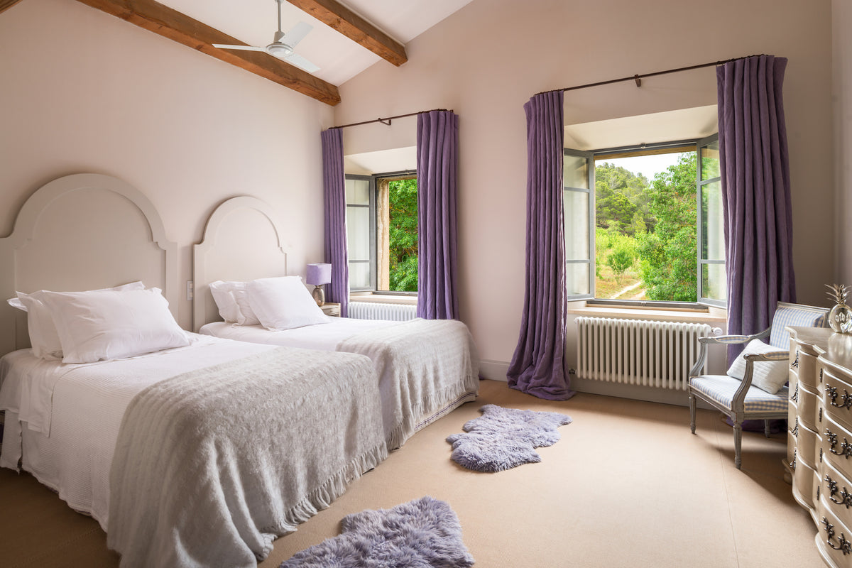 La Fraissinède, Val de Dagne, France - bedroom with two double beds and large windows overlooking countryside
