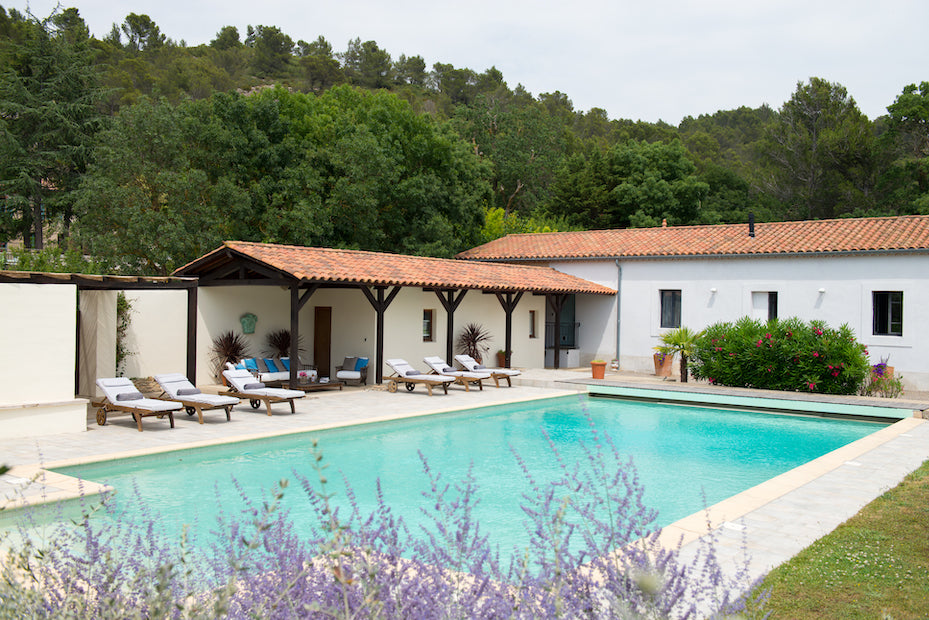 La Fraissinède, Val de Dagne, France - pool and courtyard with chaise lounges in French countryside