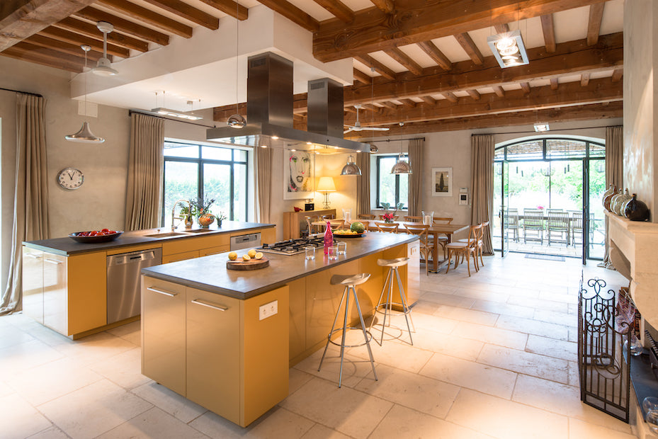 La Fraissinède, Val de Dagne, France - modern kitchen with yellow cabinets in restored country villa with wooden beam roof